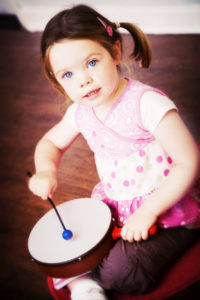 Girl playing drum