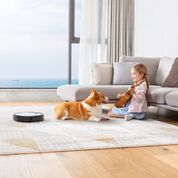 Robo Vaccum with girl and dog